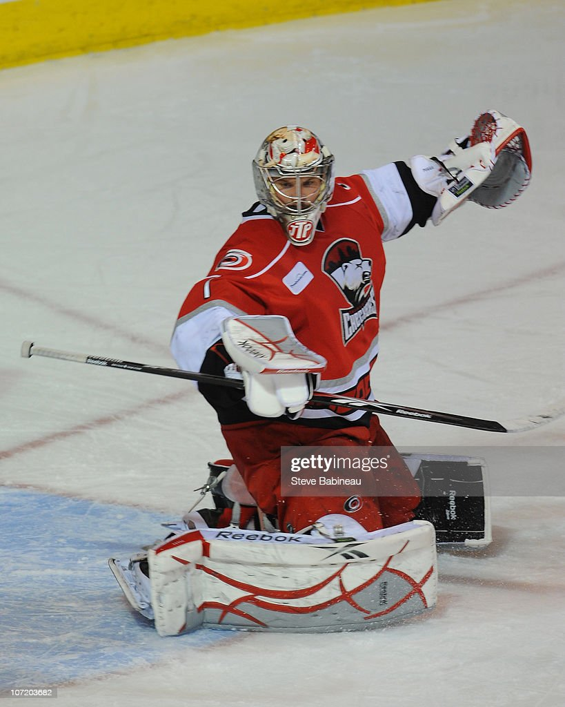 Justin Pogge #1 of the Charlotte Checkers makes a save in a game against the Worcester Sharks at the DCU Center on November 27, 2010 in Worcester Massachusetts.