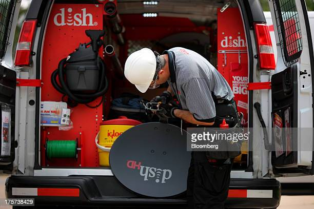 Justin Preziosi field service specialist for Dish Network Corp prepares to install a satellite television system at a residence in Denver Colorado US...