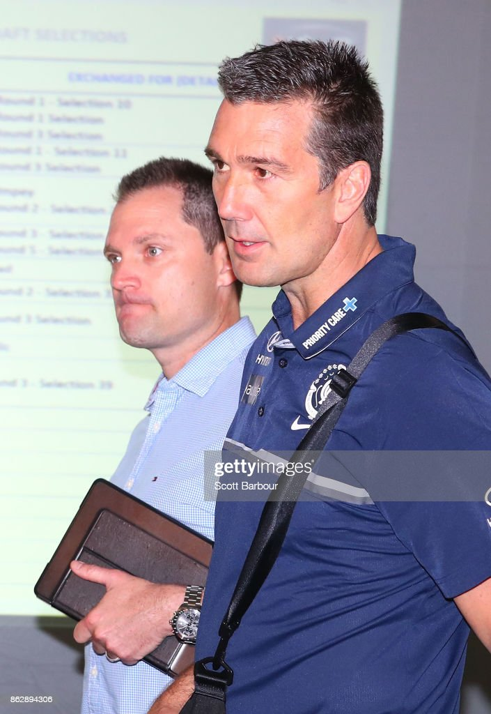 Justin Reid, List Manager of the Crows (left) and Stephen Silvagni, List Manager of the Blues (right) arrive together to attend the AFL Draft Period at Etihad Stadium on October 19, 2017 in Melbourne, Australia.