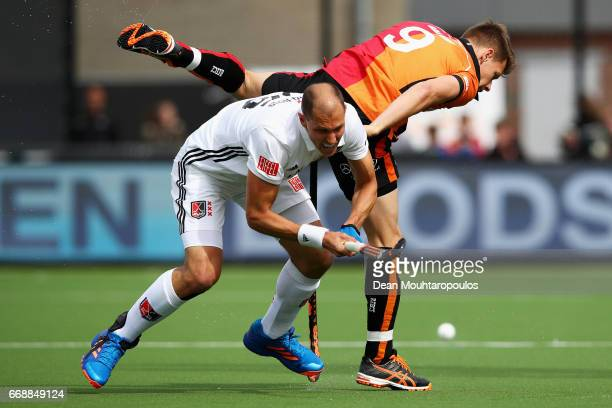 Justin ReidRoss of AH BC Amsterdam battles for the ball with Jelle Galema of HC OranjeRood during the Euro Hockey League KO16 match between HC...