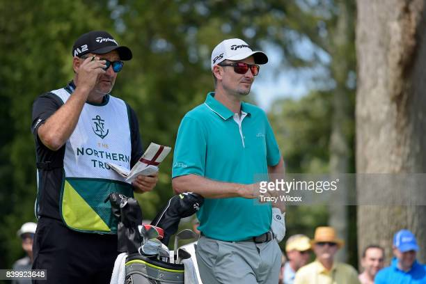 Justin Rose and caddie discuss the second hole during the final round of THE NORTHERN TRUST at Glen Oaks Club on August 27 in Old Westbury New York