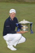 Justin Rose celebrates winning the final round of the Aberdeen Asset Management Scottish Open at Royal Aberdeen on July 13 2014 in Aberdeen Scotland