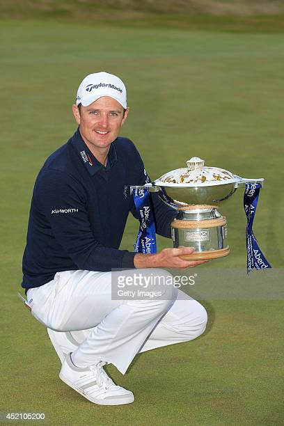 Justin Rose celebrates winning the final round of the Aberdeen Asset Management Scottish Open at Royal Aberdeen on July 13 2014 in Aberdeen Scotland