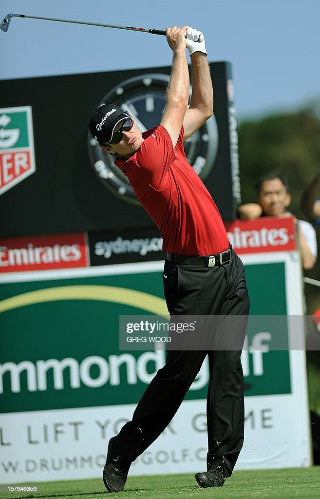 Justin Rose from England plays a tee shot during round three of the Australian Open golf at The Lakes course in Sydney on December 8, 2012. IMAGE STRICTLY RESTRICTED TO EDITORIAL USE - STRICTLY NO COMMERCIAL USE AFP PHOTO / Greg WOOD