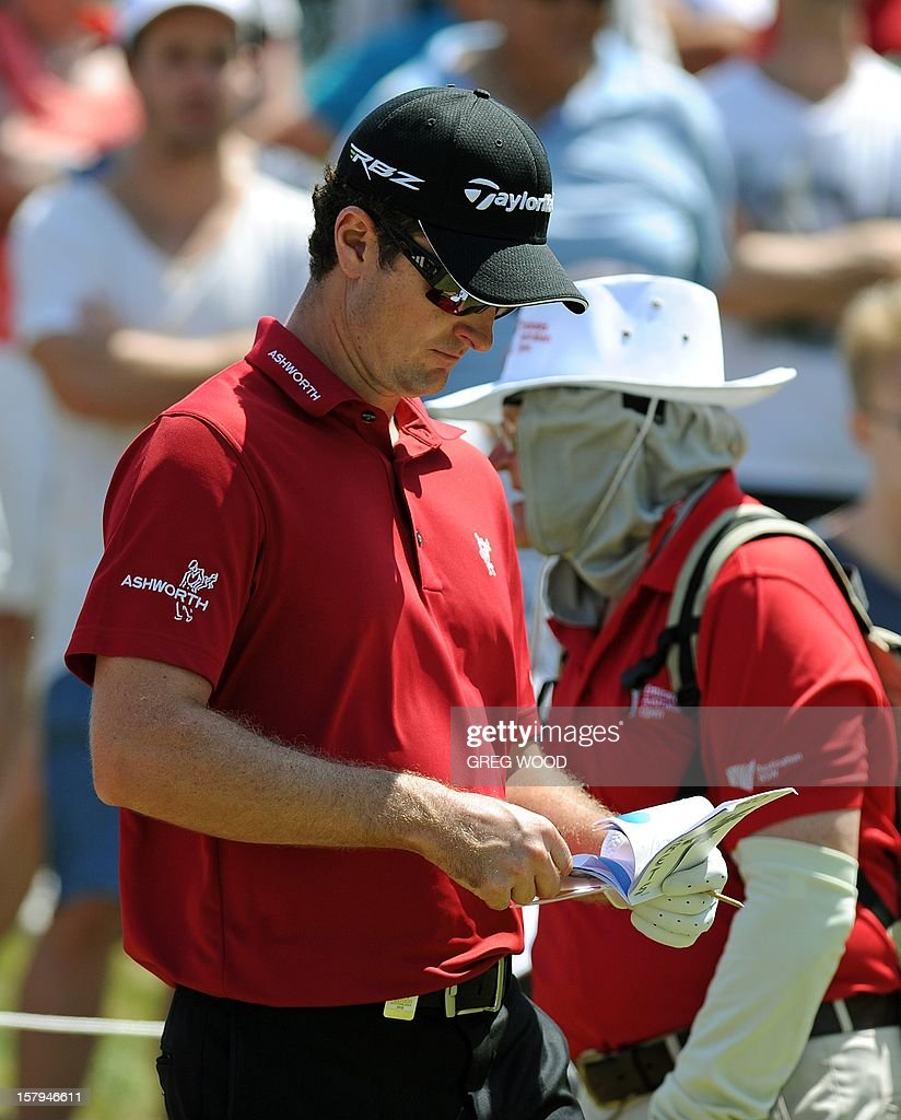 Justin Rose from England (C) walks to the 12th tee during round three of the Australian Open golf at The Lakes course in Sydney on December 8, 2012. IMAGE STRICTLY RESTRICTED TO EDITORIAL USE - STRICTLY NO COMMERCIAL USE AFP PHOTO / Greg WOOD
