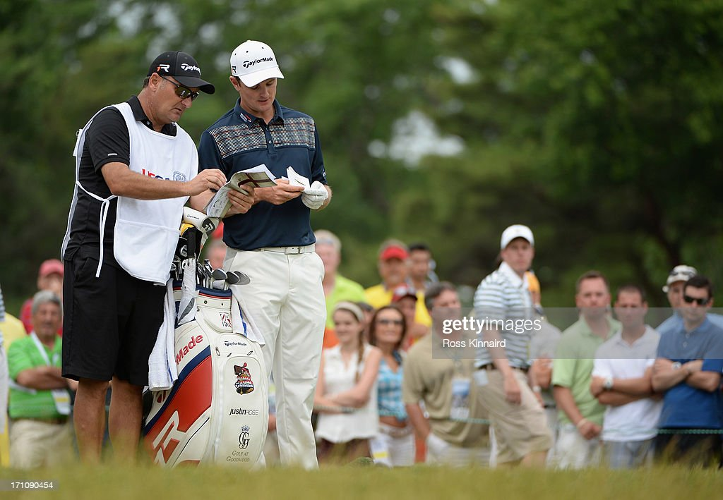 Justin Rose (R) of England and caddie Mark Fulcher (L) wait on the ninth tee during the final round of the 113th U.S. Open at Merion Golf Club on June 16, 2013 in Ardmore, Pennsylvania.