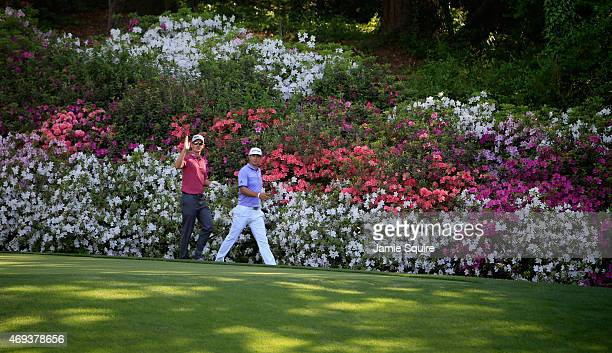 Justin Rose of England and Dustin Johnson of the United States walk the 13th hole during the third round of the 2015 Masters Tournament at Augusta...