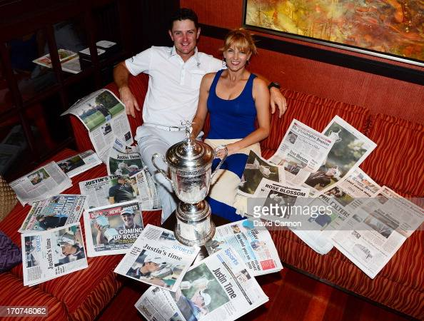 Justin Rose of England and his wife Kate Rose and the morning papers as they looked at the photographs and stories of his 2013 US Open win at Merion...