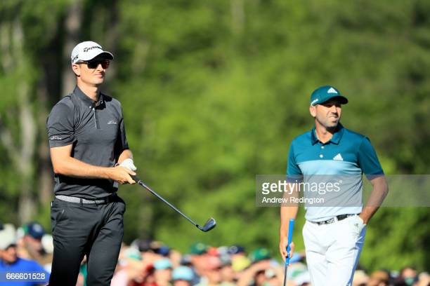 Justin Rose of England and Sergio Garcia of Spain look on from the 12th tee during the final round of the 2017 Masters Tournament at Augusta National...
