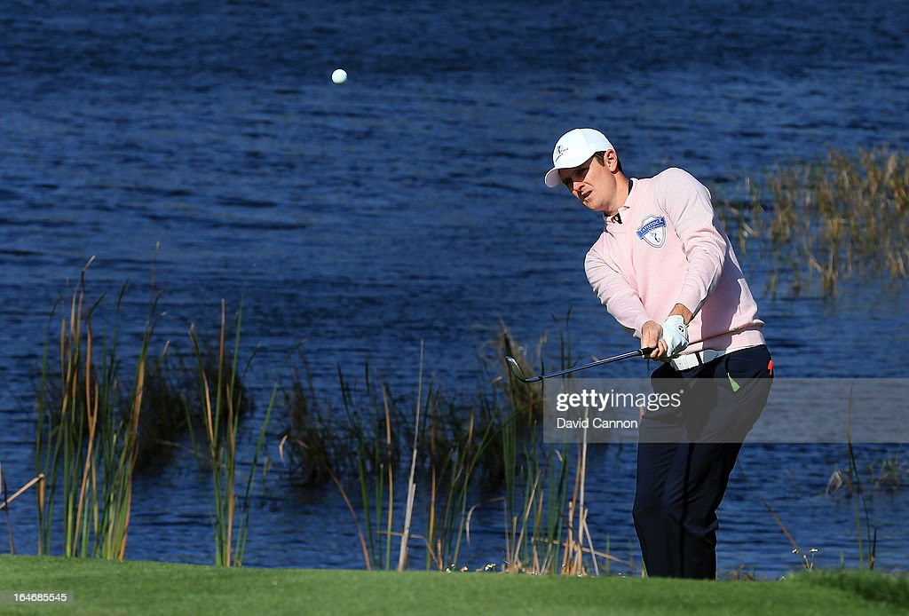 Justin Rose of England and the Albany Team plays his second shot at the 2nd hole during the final day of the 2013 Tavistock Cup Matches at Isleworth Golf and Country Club on March 26, 2013 in Orlando, Florida.