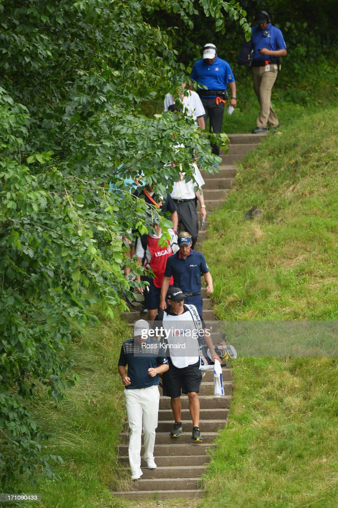 Justin Rose of England, caddie Mark Fulcher, Luke Donald of England and caddie John McLaren walk down off the tenth tee during the final round of the 113th U.S. Open at Merion Golf Club on June 16, 2013 in Ardmore, Pennsylvania.