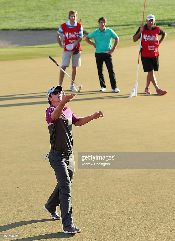 Justin Rose of England catches his putter after missing a putt to go to a play-off on the 18th hole during the final round of The Abu Dhabi HSBC Golf Championship at Abu Dhabi Golf Club on January 20, 2013 in Abu Dhabi, United Arab Emirates.