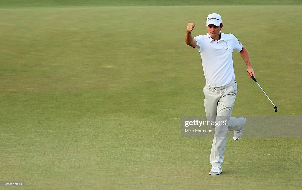 Justin Rose of England celebrates a birdie putt on the 18th green during the final round of the 114th U.S. Open at Pinehurst Resort & Country Club, Course No. 2 on June 15, 2014 in Pinehurst, North Carolina.