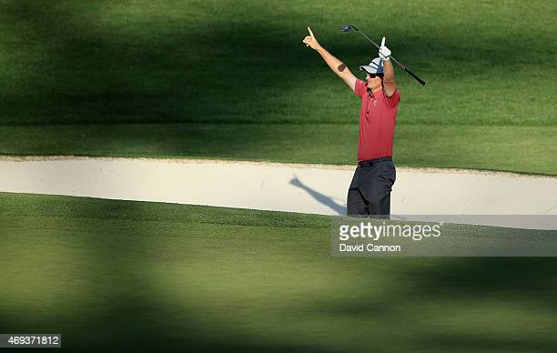 Justin Rose of England celebrates after holing a bunker shot on the 16th hole during the third round of the 2015 Masters Tournament at Augusta...