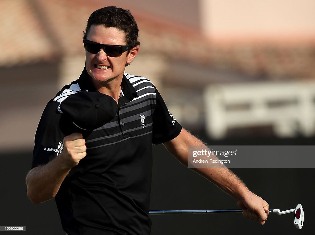 Justin Rose of England celebrates as he birdies the 18th hole during the final round of the DP World Tour Championship on the Earth Course at Jumeirah Golf Estates on November 25, 2012 in Dubai, United Arab Emirates.