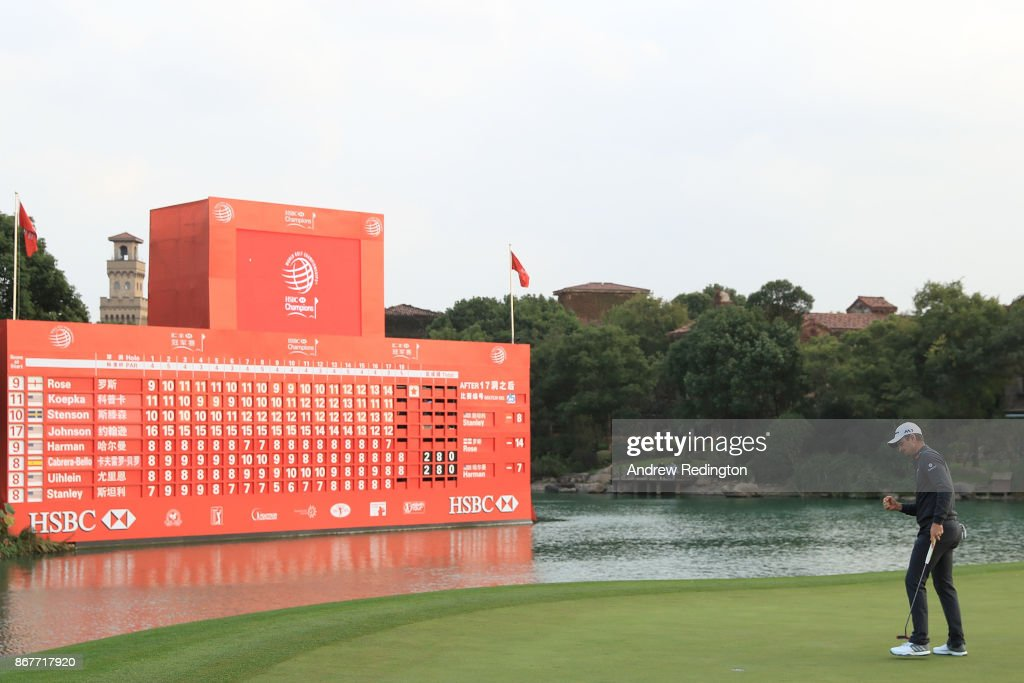 Justin Rose of England celebrates on the 18th green after finishing 14 under during the final round of the WGC - HSBC Champions at Sheshan International Golf Club on October 29, 2017 in Shanghai, China.