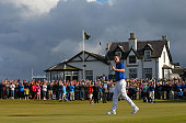 Justin Rose of England celebrates on the 18th hole after winning the 2014 Aberdeen Asset Management Scottish Open at Royal Aberdeen Golf Club on July...