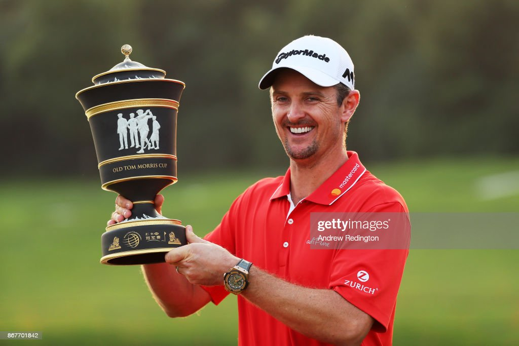 Justin Rose of England celebrates with the Old Tom Morris Cup after finishing 14 under to win the WGC - HSBC Champions at Sheshan International Golf Club on October 29, 2017 in Shanghai, China.