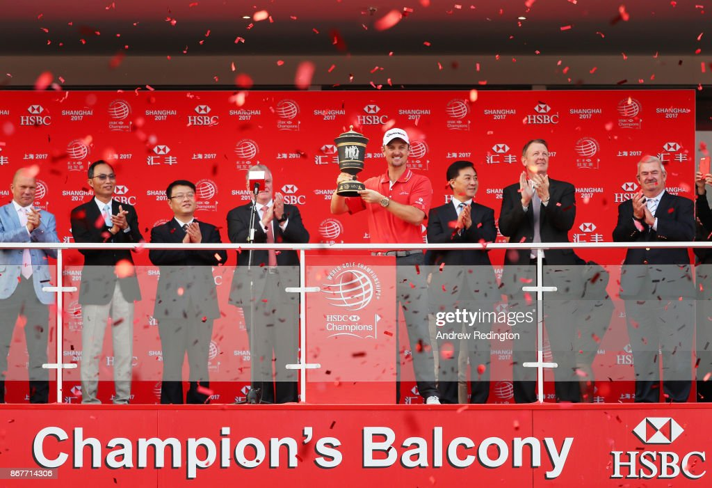 Justin Rose of England celebrates with the Old Tom Morris Cup on the Champion's Balcony after finishing 14 under to win the WGC - HSBC Champions at Sheshan International Golf Club on October 29, 2017 in Shanghai, China.