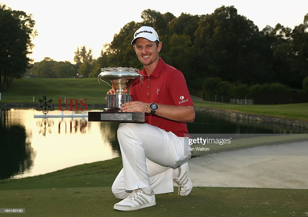 Justin Rose of England celebrates with the trophy after winning the final round of the UBS Hong Kong Open at The Hong Kong Golf Club on October 25, 2015 in Hong Kong, Hong Kong.