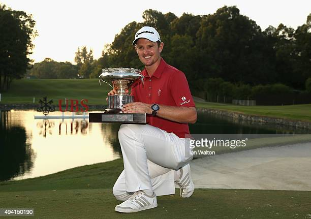 Justin Rose of England celebrates with the trophy after winning the final round of the UBS Hong Kong Open at The Hong Kong Golf Club on October 25...