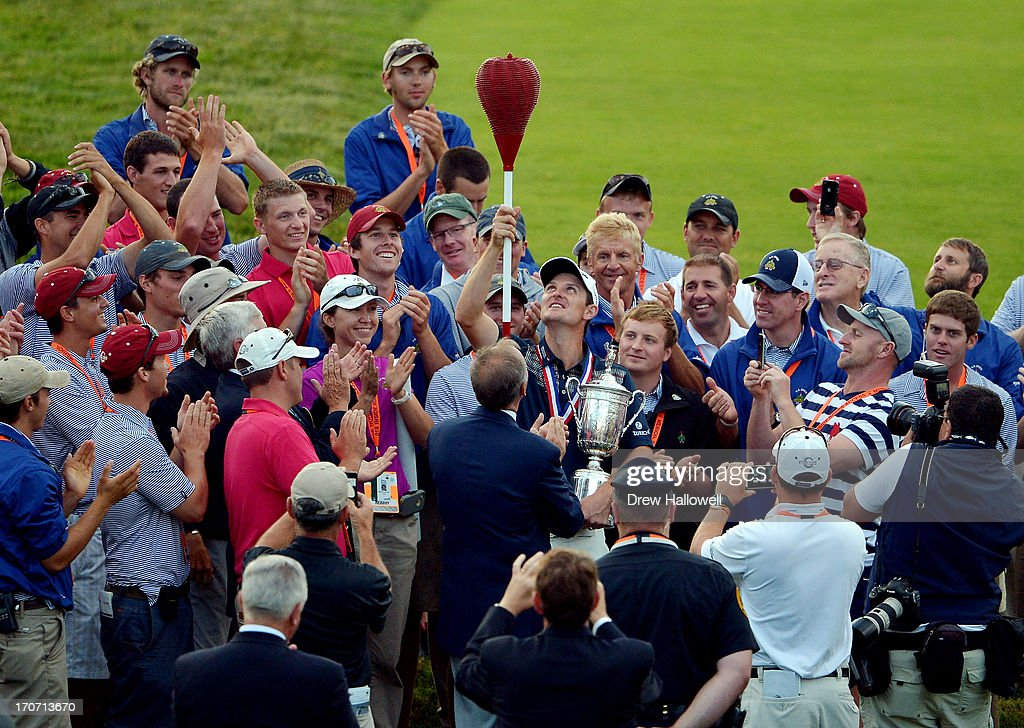 <a gi-track='captionPersonalityLinkClicked' href=/galleries/search?phrase=Justin+Rose&family=editorial&specificpeople=171559 ng-click='$event.stopPropagation()'>Justin Rose</a> of England celebrates with the U.S. Open trophy admist a group of people while holding a wicker basket flagstick after winning the 113th U.S. Open at Merion Golf Club on June 16, 2013 in Ardmore, Pennsylvania.
