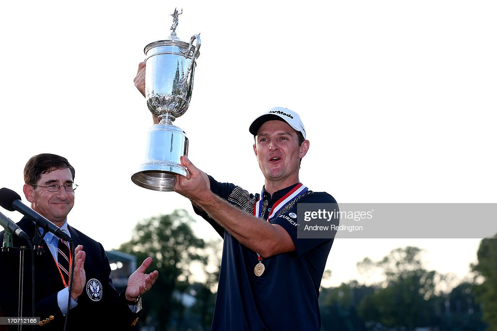 Justin Rose of England celebrates with the US Open trophy after winning the 113th US Open at Merion Golf Club on June 16 2013 in Ardmore Pennsylvania