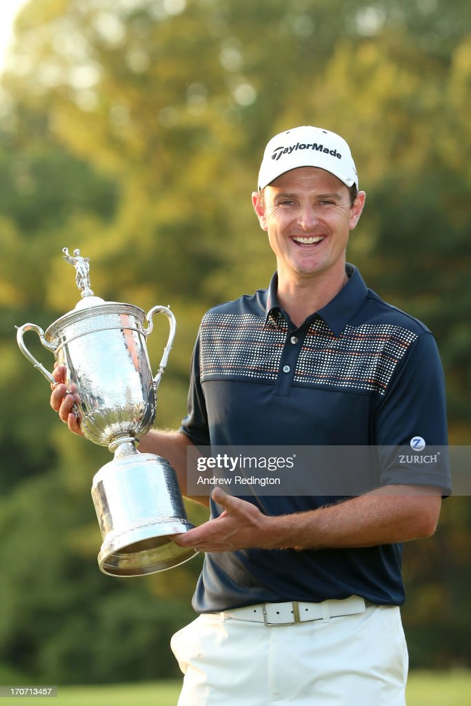Justin Rose of England celebrates with the U.S. Open trophy after winning the 113th U.S. Open at Merion Golf Club on June 16, 2013 in Ardmore, Pennsylvania.