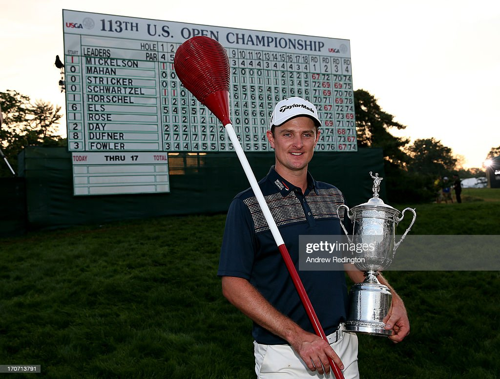 Justin Rose of England celebrates with the US Open trophy while holding a wicker basket flagstick after winning the 113th US Open at Merion Golf Club...