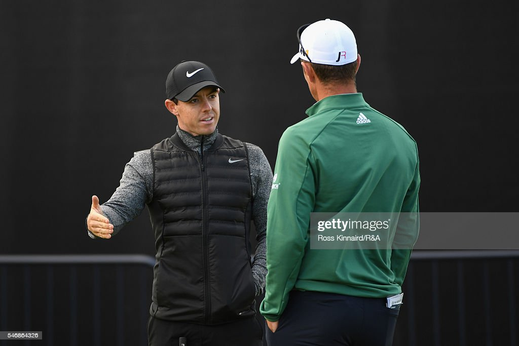 Justin Rose of England chats to Rory McIlroy of Northern Ireland (L) on the putting green during previews to the 145th Open Championship at Royal Troon on July 13, 2016 in Troon, Scotland.