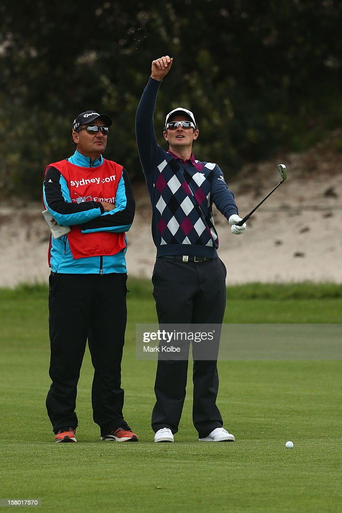 Justin Rose of England checks the wind direction during round four of the 2012 Australian Open at The Lakes Golf Club on December 9, 2012 in Sydney, Australia.
