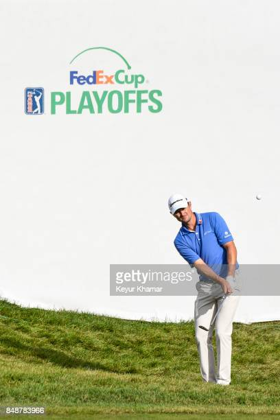 Justin Rose of England chips a shot to the 17th hole green during the final round of the BMW Championship at Conway Farms Golf Club on September 17...
