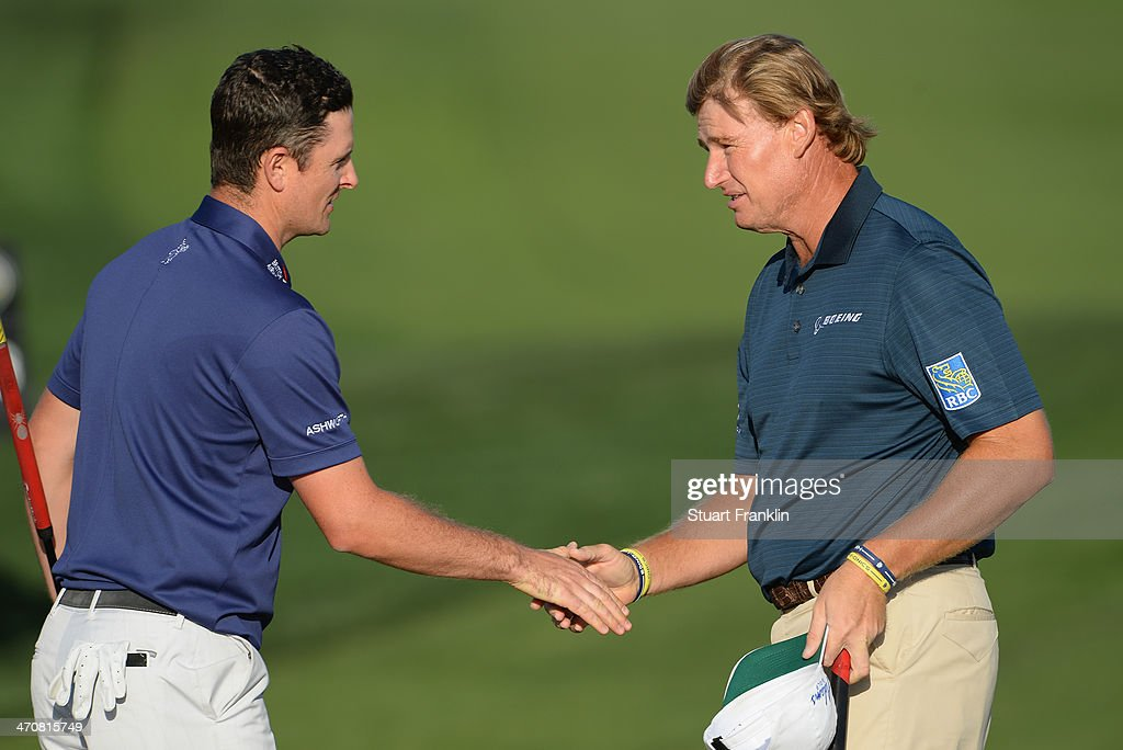 Justin Rose of England congratulates Ernie Els of South Africa on the second play off hole during the second round of the World Golf Championships - Accenture Match Play Championship at The Golf Club at Dove Mountain on February 20, 2014 in Marana, Arizona.