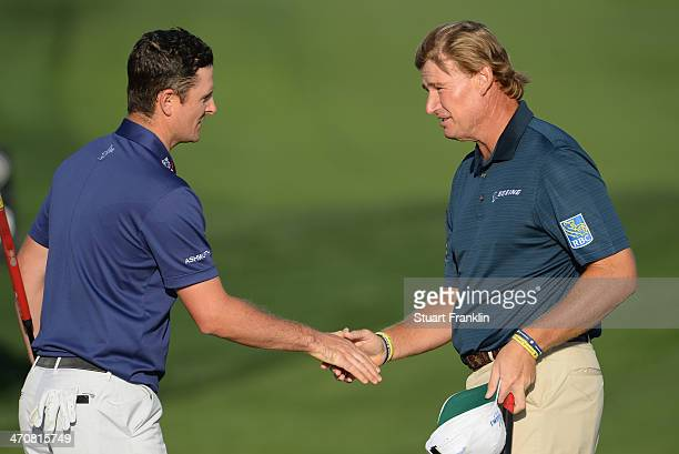Justin Rose of England congratulates Ernie Els of South Africa on the second play off hole during the second round of the World Golf Championships...