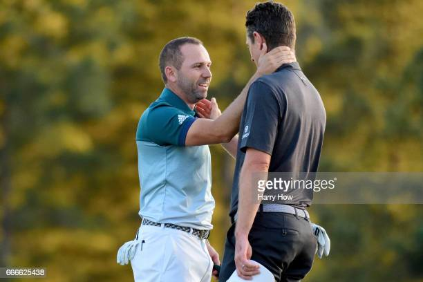 Justin Rose of England congratulates Sergio Garcia of Spain after Garcia won on the first playoff hole during the final round of the 2017 Masters...