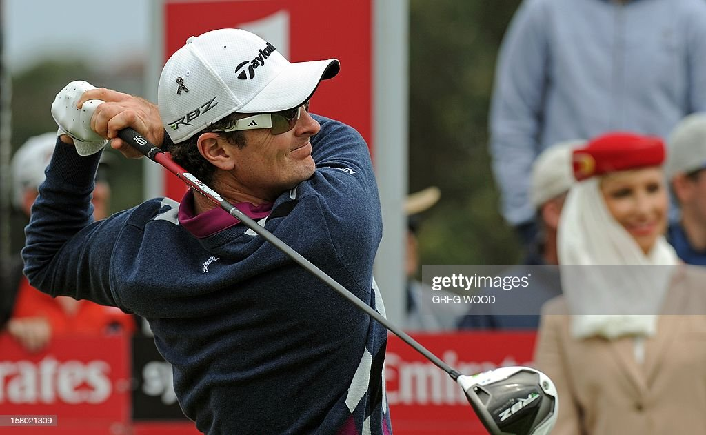Justin Rose of England drives off the number one tee to begin his final round after play had earlier been suspended due to high winds at the Australian Open golf at The Lakes course in Sydney on December 9, 2012. IMAGE STRICTLY RESTRICTED TO EDITORIAL USE - STRICTLY NO COMMERCIAL USE AFP PHOTO / Greg WOOD