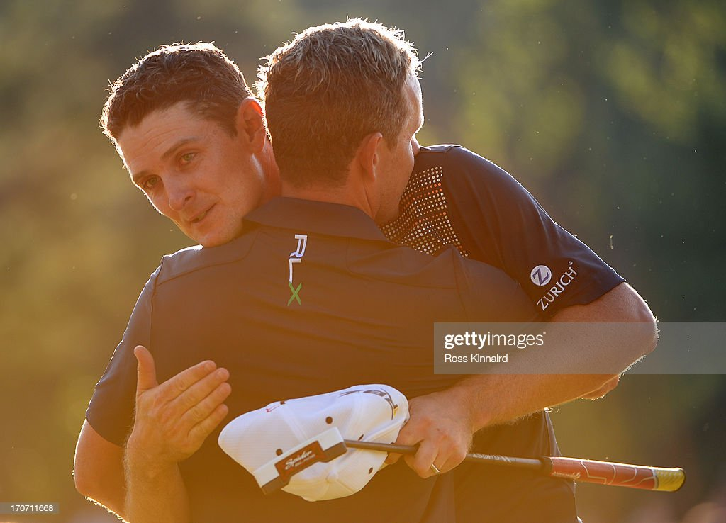 Justin Rose of England embraces caddie Mark Fulcher after putting on the 18th hole to complete the final round of the 113th U.S. Open at Merion Golf Club on June 16, 2013 in Ardmore, Pennsylvania.