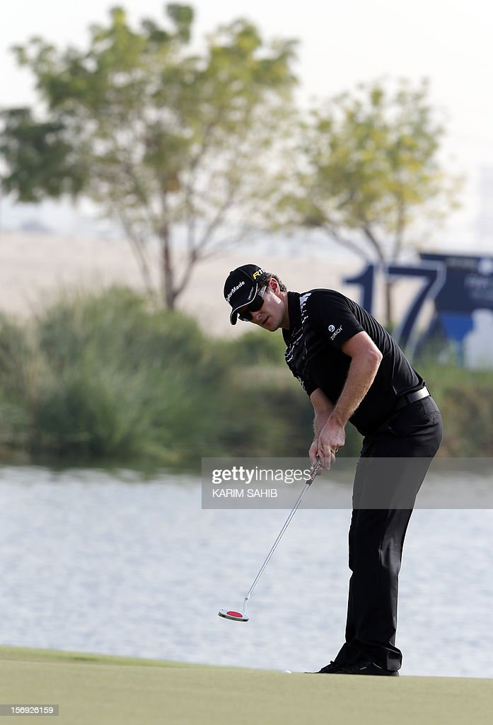Justin Rose of England follows his ball during the 4rd round of the DP World Tour Championship in the Gulf emirate of Dubai on November 25, 2012. Rory McIlroy responded in magnificent fashion to Justin Rose's course record round of 10-under par 62 by making five birdies in his last five holes to win the DP World Tour Championship in Dubai.