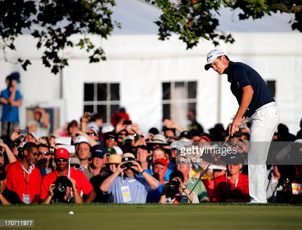 Justin Rose of England hits a chip shot on the 18th green during the final round of the 113th US Open at Merion Golf Club on June 16 2013 in Ardmore...