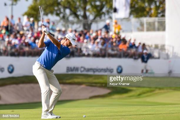 Justin Rose of England hits a shot from the 18th hole fairway during the final round of the BMW Championship at Conway Farms Golf Club on September...