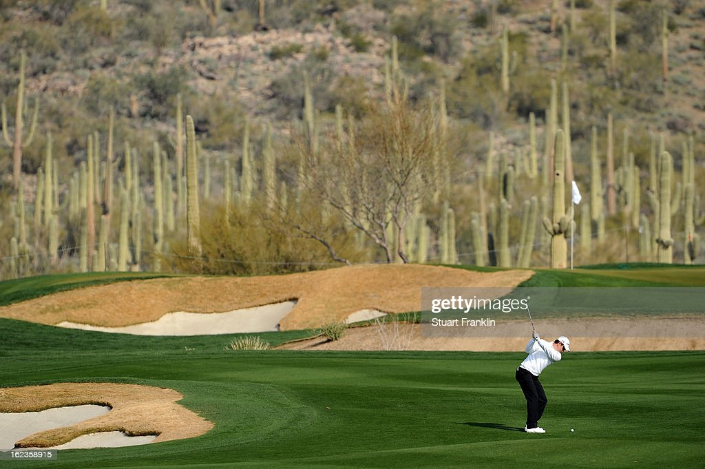 Justin Rose of England hits a shot from the fairway on the fourth hole during the second round of the World Golf Championships - Accenture Match Play at the Golf Club at Dove Mountain on February 22, 2013 in Marana, Arizona.