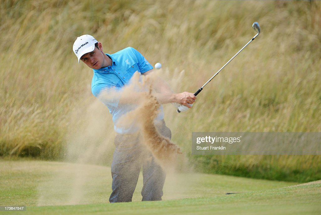 <a gi-track='captionPersonalityLinkClicked' href=/galleries/search?phrase=Justin+Rose&family=editorial&specificpeople=171559 ng-click='$event.stopPropagation()'>Justin Rose</a> of England hits a shot out of the bunker ahead of the 142nd Open Championship at Muirfield on July 16, 2013 in Gullane, Scotland.