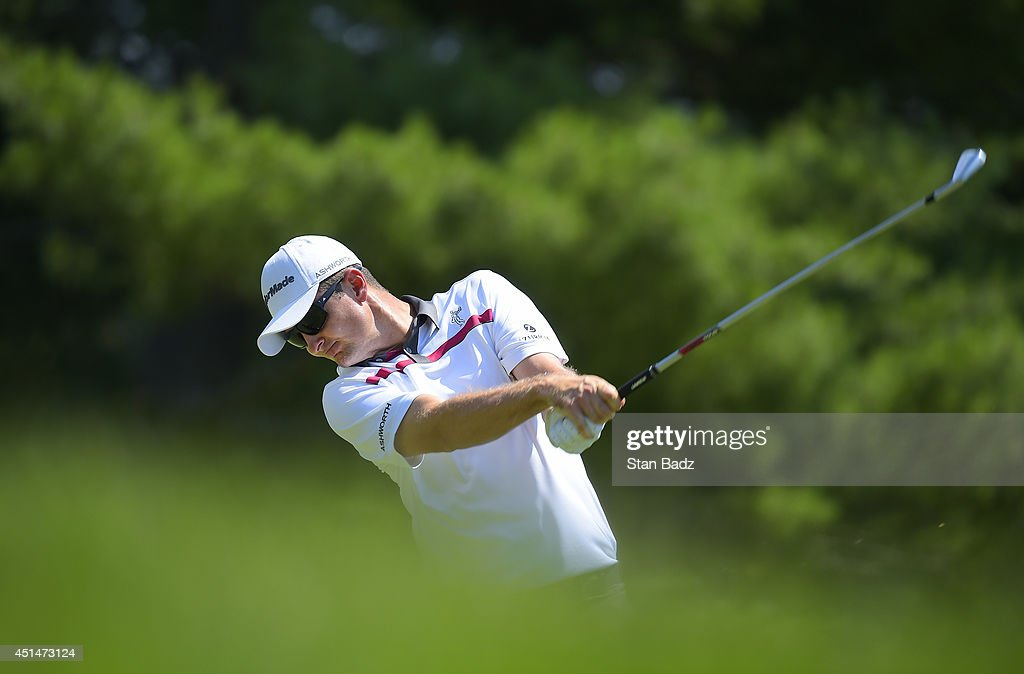 Justin Rose of England hits a tee shot on the second hole during the final round of the Quicken Loans National at Congressional Country Club on June 29, 2014 in Bethesda, Maryland.