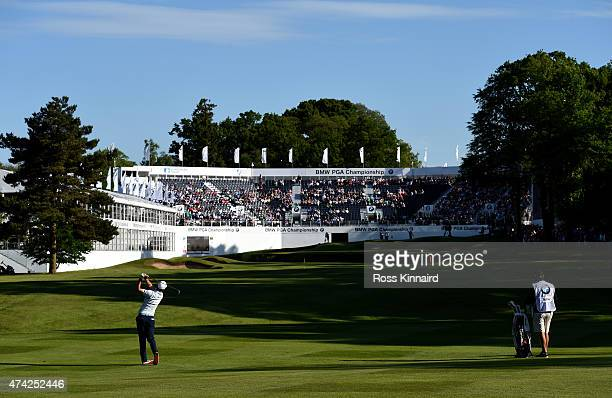 Justin Rose of England hits an approach shot on the18th hole during day 1 of the BMW PGA Championship at Wentworth on May 21 2015 in Virginia Water...