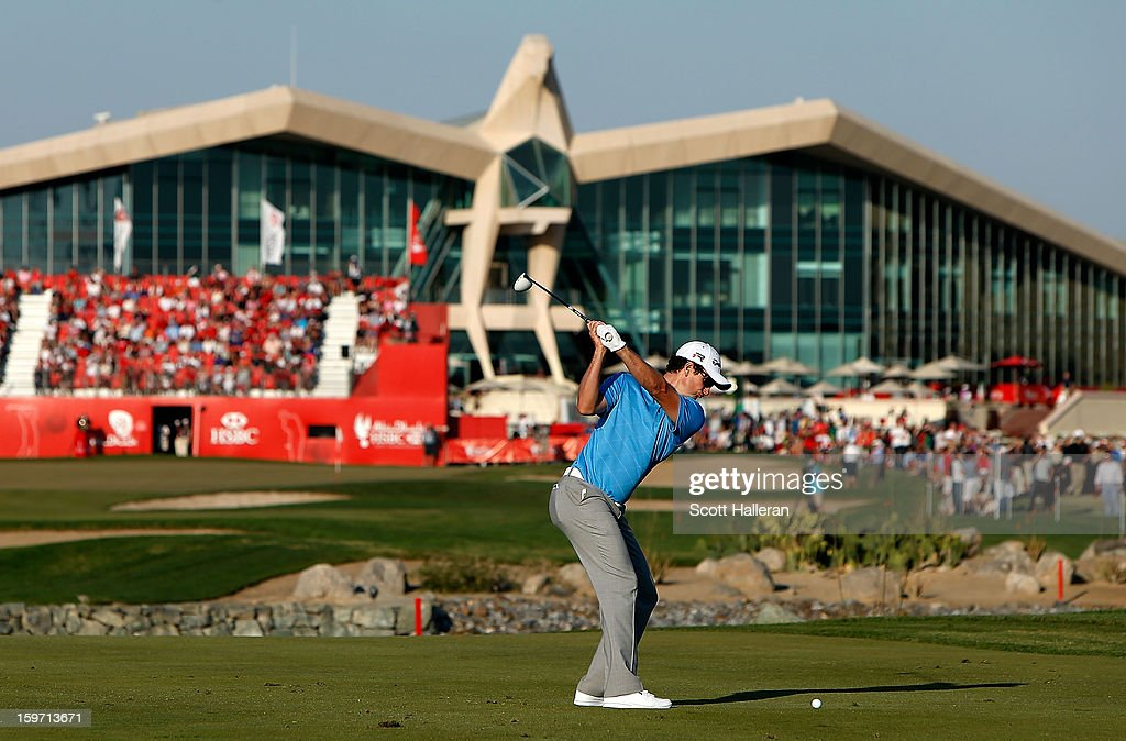 <a gi-track='captionPersonalityLinkClicked' href=/galleries/search?phrase=Justin+Rose&family=editorial&specificpeople=171559 ng-click='$event.stopPropagation()'>Justin Rose</a> of England hits his approach shot on the 18th hole during the third round of the Abu Dhabi HSBC Golf Championship at Abu Dhabi Golf Club on January 19, 2013 in Abu Dhabi, United Arab Emirates.