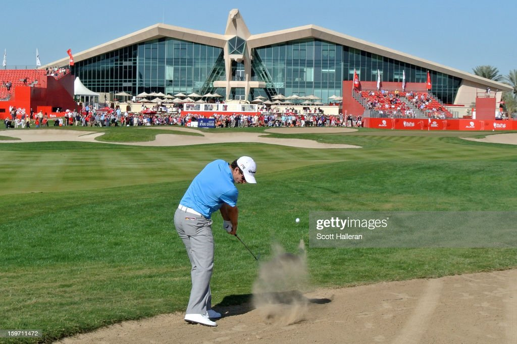 Justin Rose of England hits his approach shot on the ninth hole during the third round of the Abu Dhabi HSBC Golf Championship at Abu Dhabi Golf Club on January 19, 2013 in Abu Dhabi, United Arab Emirates.