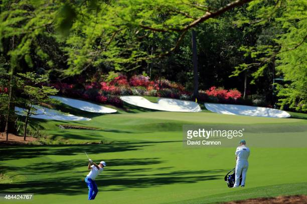 Justin Rose of England hits his second shot on the 13th hole during the third round of the 2014 Masters Tournament at Augusta National Golf Club on...