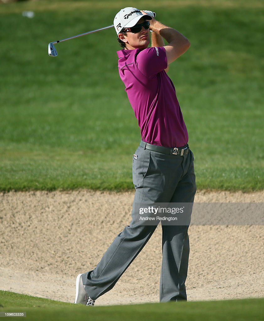 Justin Rose of England hits his second shot on the 14th hole during the first round of The Abu Dhabi HSBC Golf Championship at Abu Dhabi Golf Club on January 17, 2013 in Abu Dhabi, United Arab Emirates.