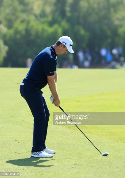 Justin Rose of England hits his second shot on the 2nd hole during the final round of the DP World Tour Championship at Jumeirah Golf Estates on...