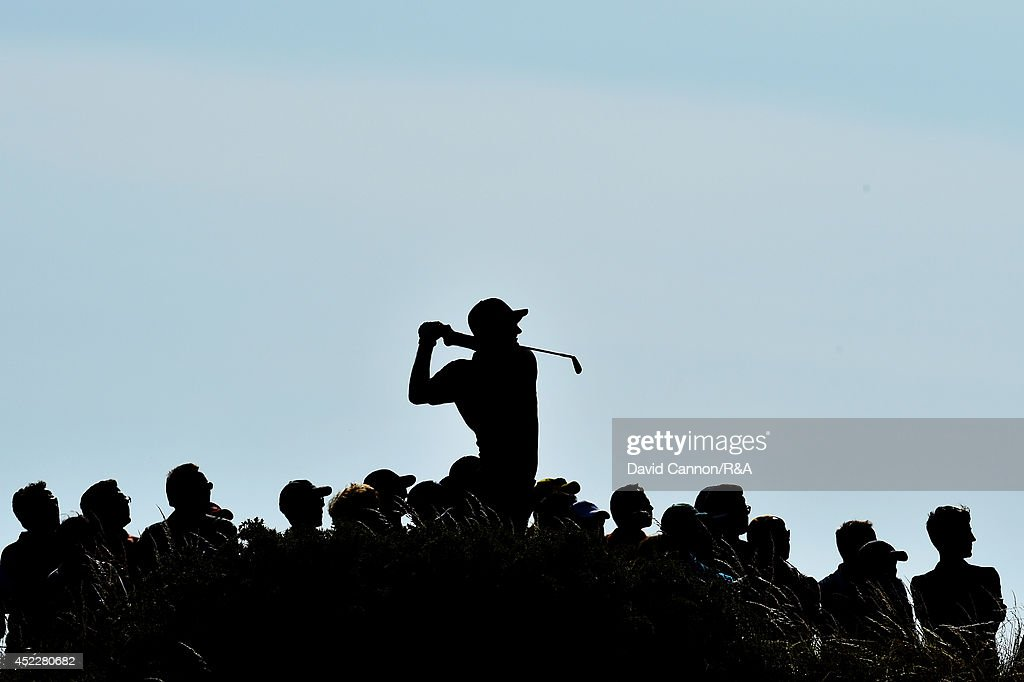 <a gi-track='captionPersonalityLinkClicked' href=/galleries/search?phrase=Justin+Rose&family=editorial&specificpeople=171559 ng-click='$event.stopPropagation()'>Justin Rose</a> of England hits his tee shot on the 12th hole as a gallery of spectators look on during the first round of The 143rd Open Championship at Royal Liverpool on July 17, 2014 in Hoylake, England.